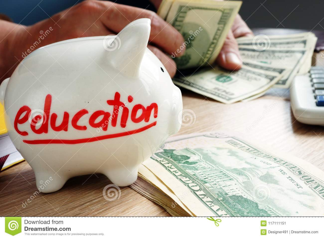 Savings for education. Hands counting money.