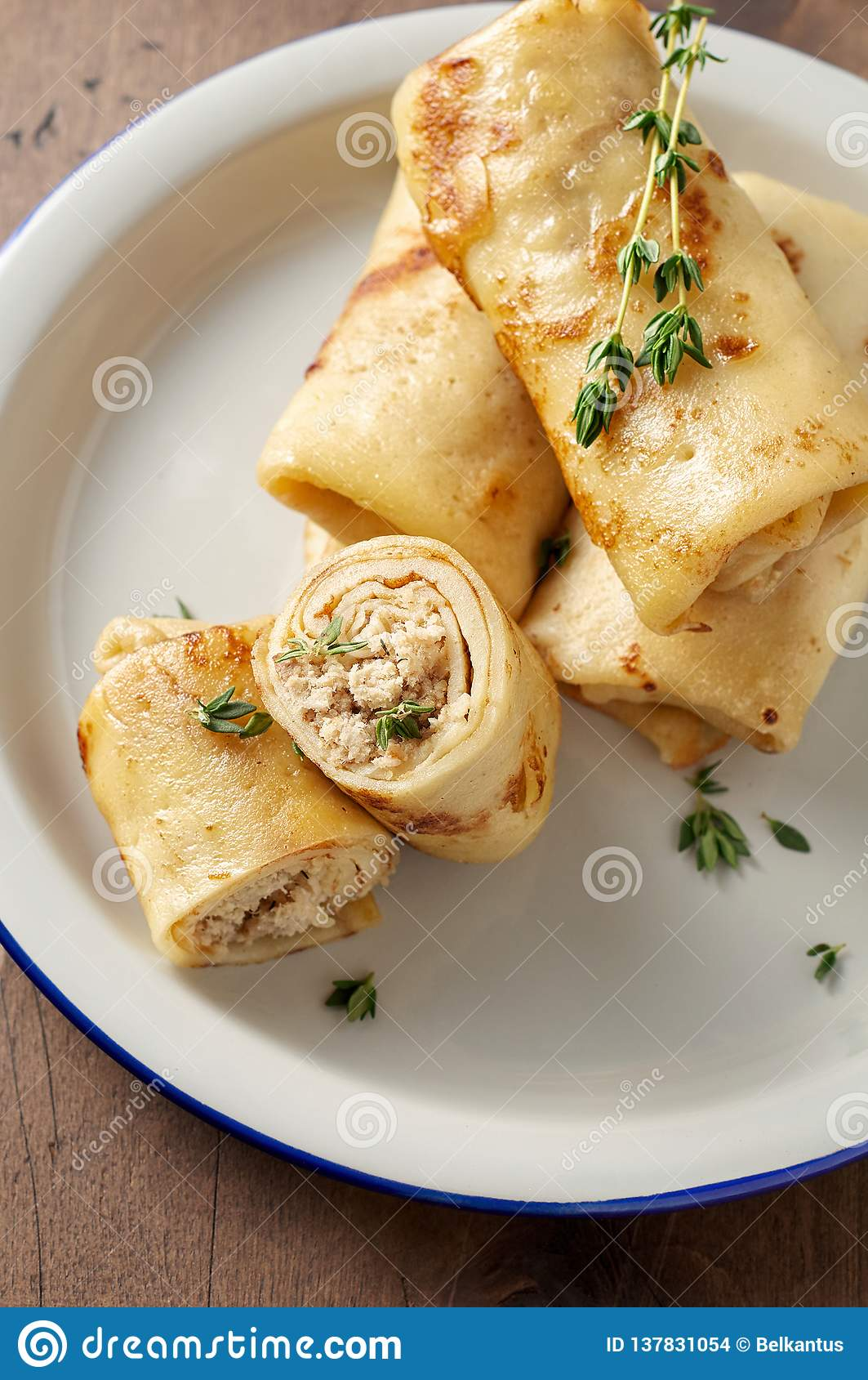 Savory crepe rolls with ground meat filling. Traditional Russian Shrovetide festival meal