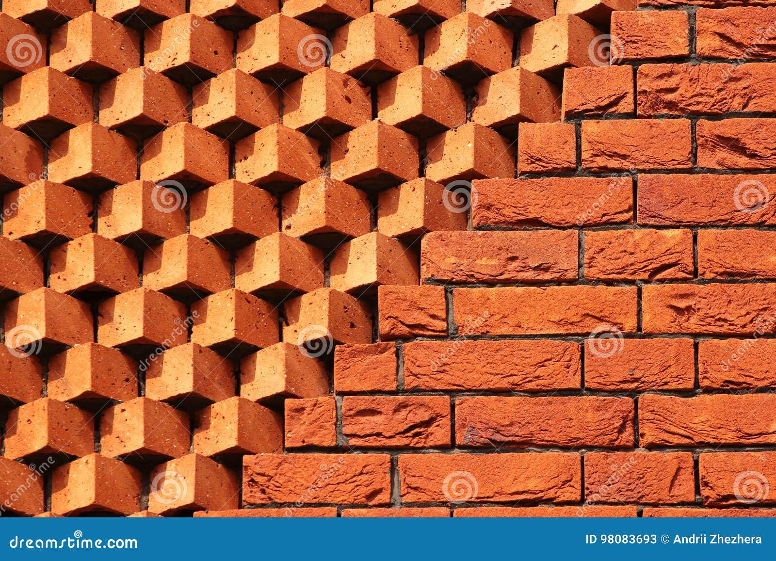 Sawtooth pattern brickwork. Decorative red brick wall as background