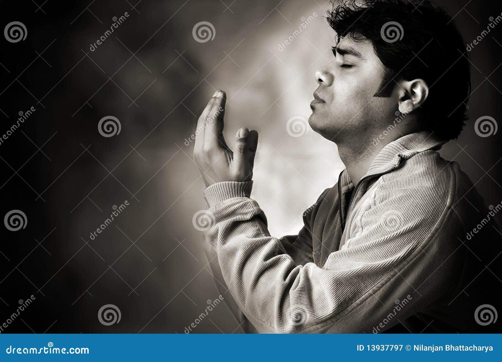 Saying a prayer to god