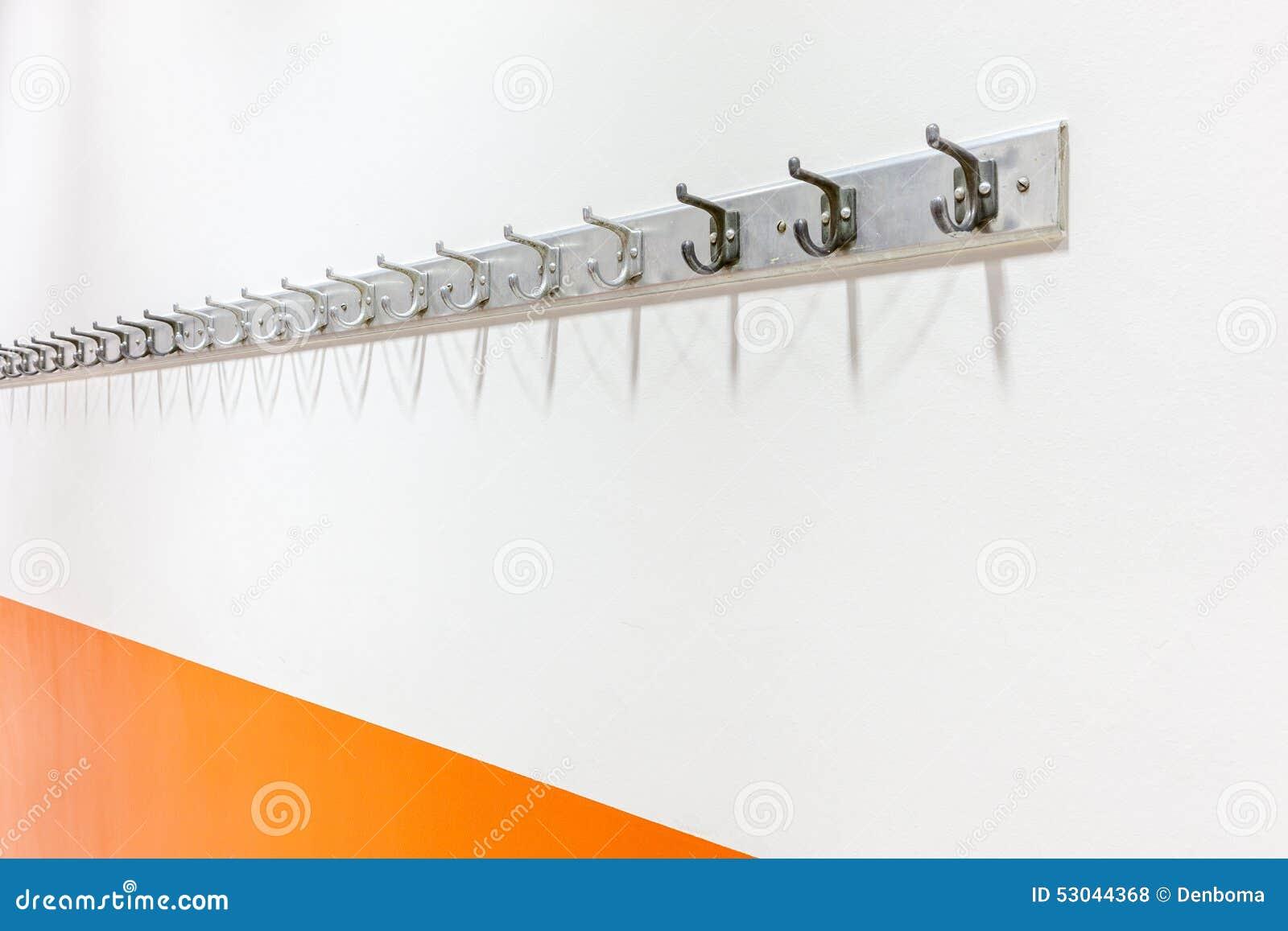 Scaffale del cappotto della parete