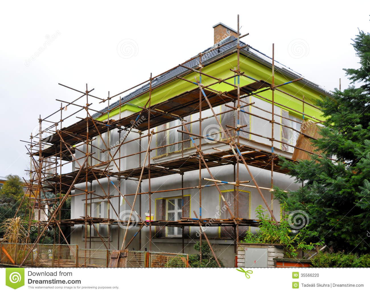 Scaffolding on the house stock photo image of blue for Home renovation builders