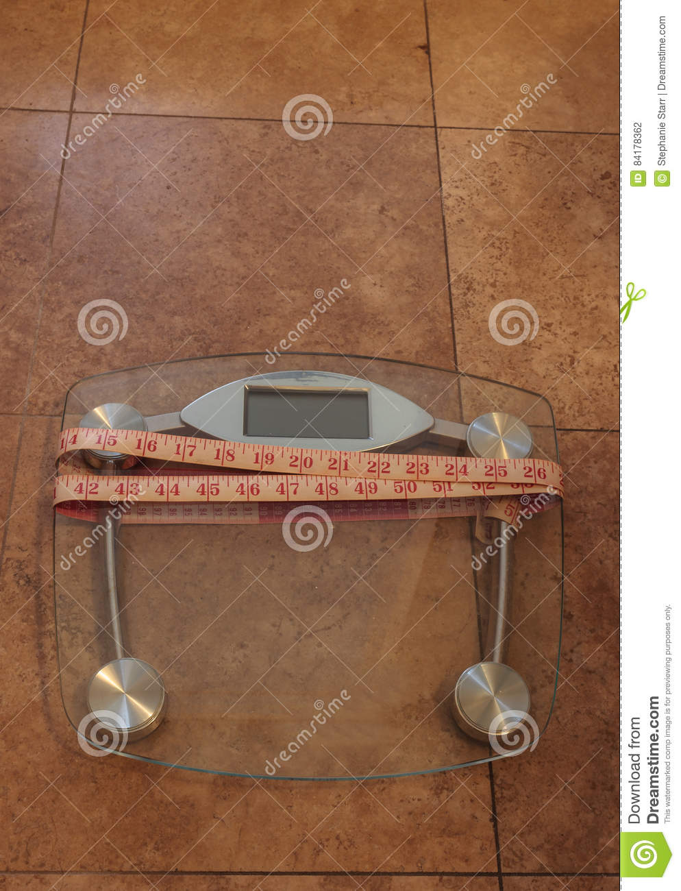 scale to monitor weight with a measuring tape stock photo image of
