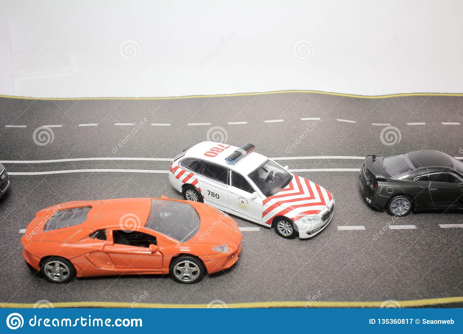 A Scale Of Traffic A Police Car Stock Image - Image of