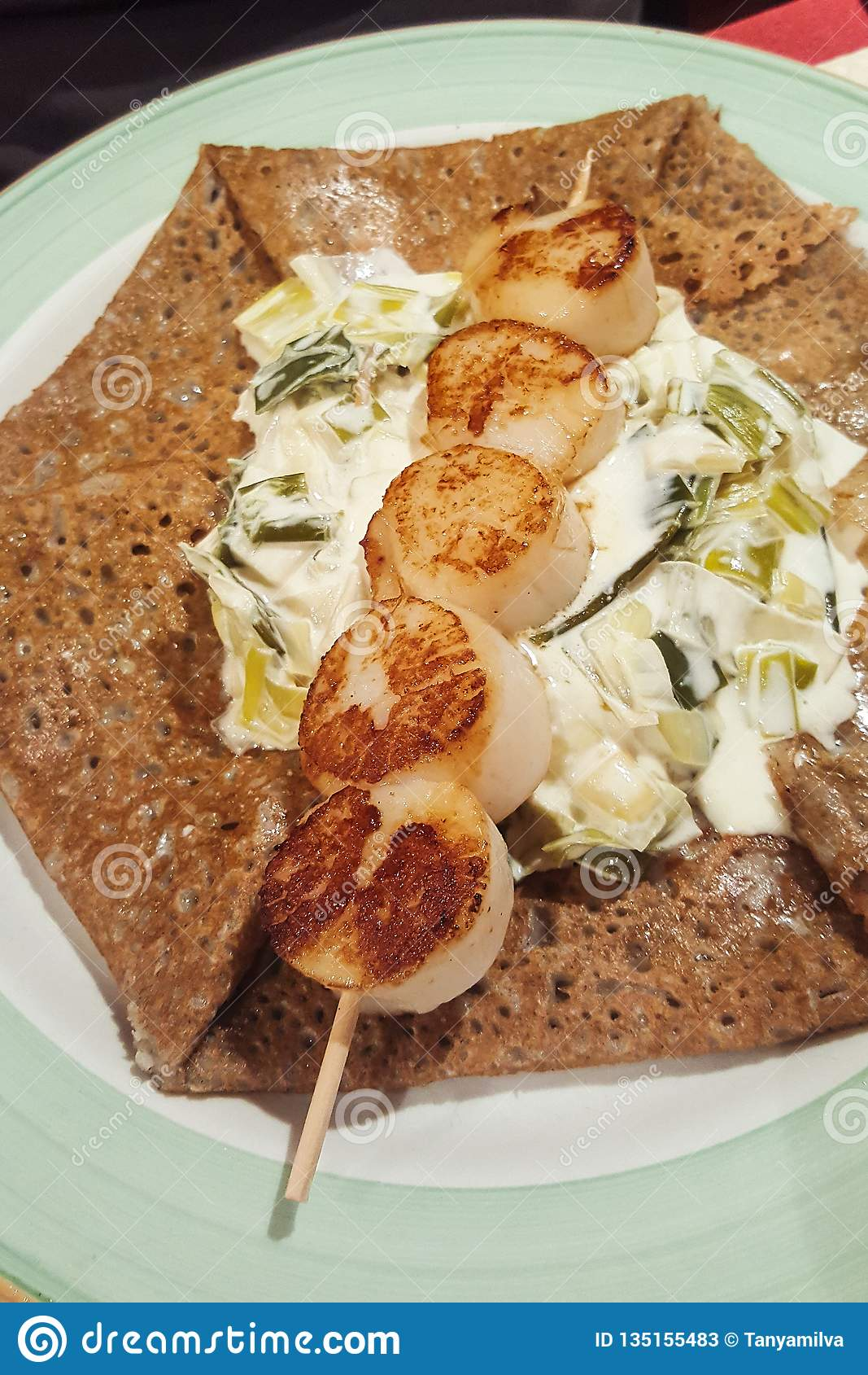 Scallop shellfish meat on skewer crepe with French pancake