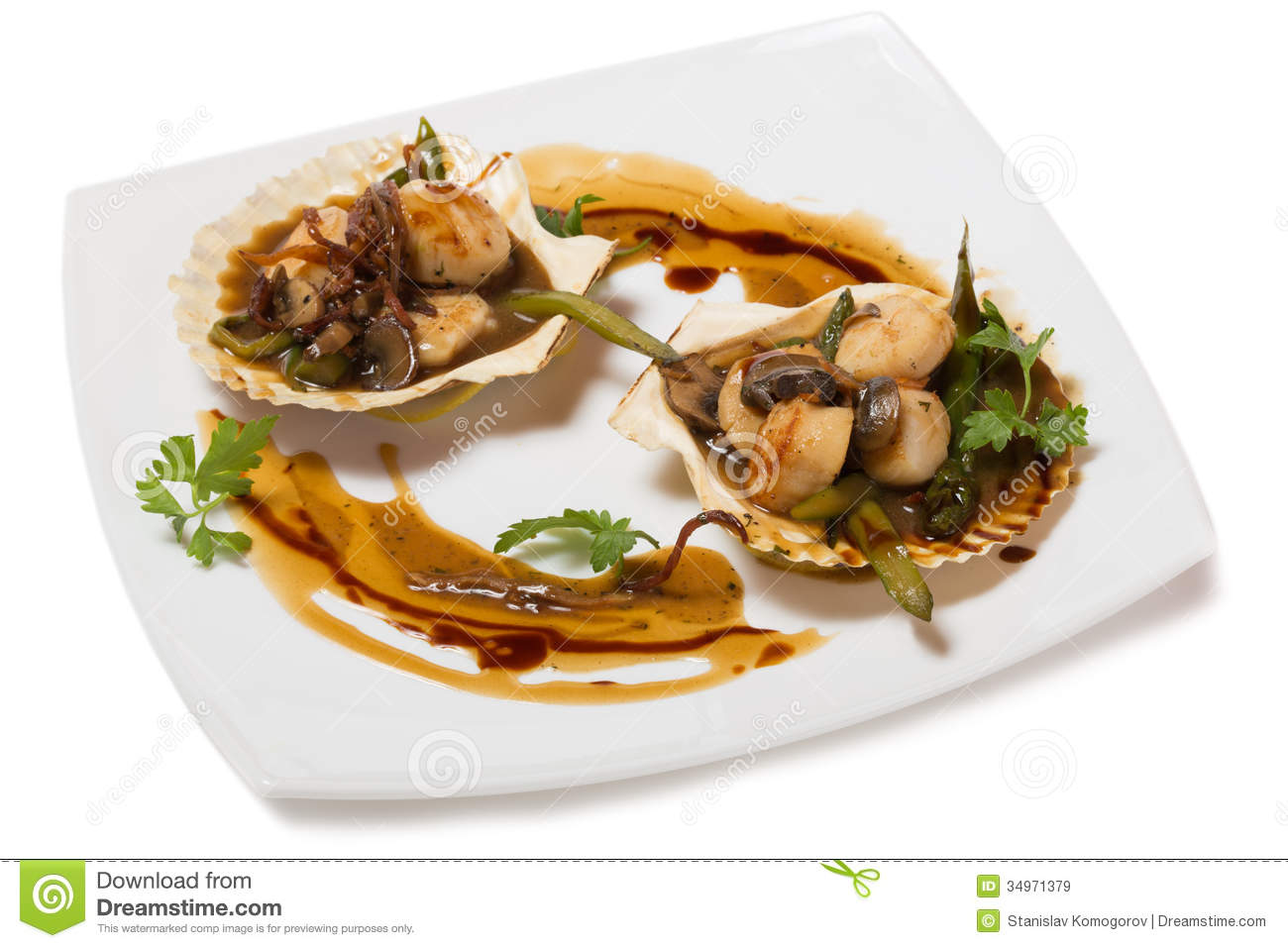 Hot starter of scallops with asparagus and mushrooms in the wings of ...