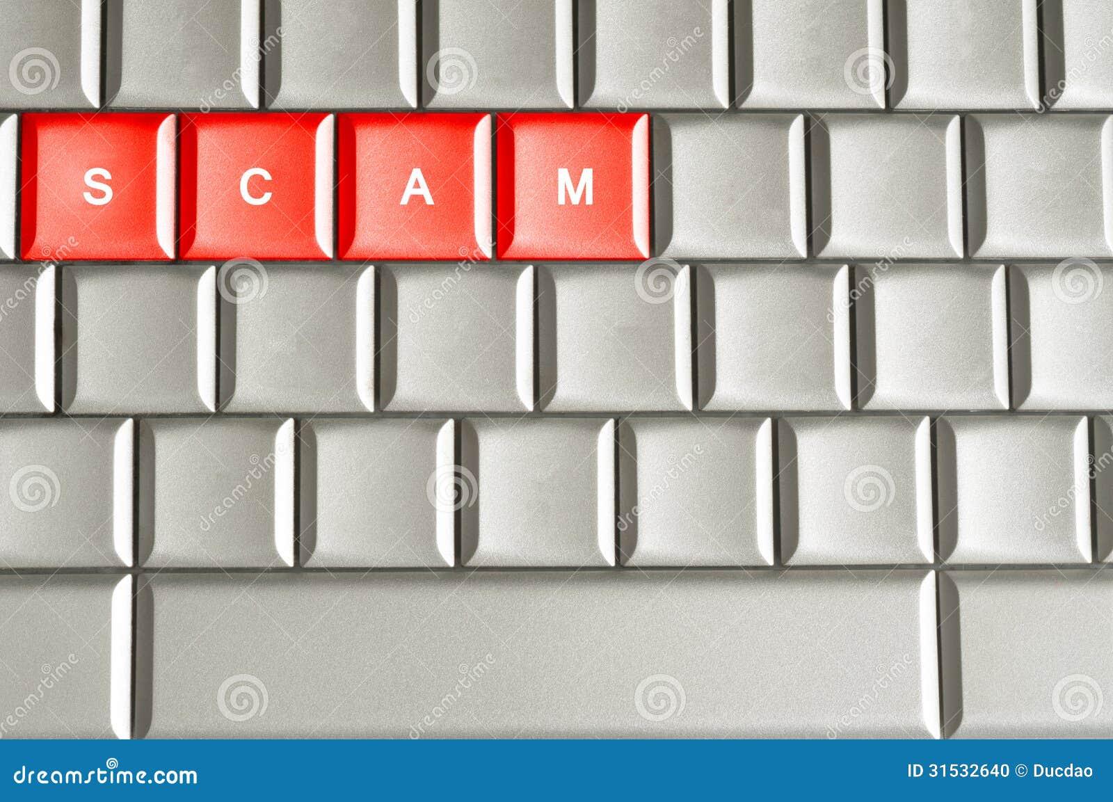 Scam ord som stavas på ett metalliskt tangentbord