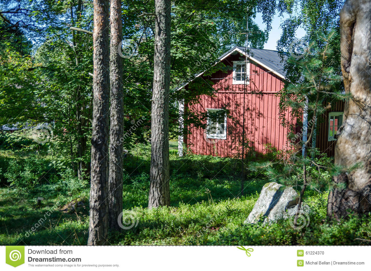 Scandinavian old red wooden house in forest
