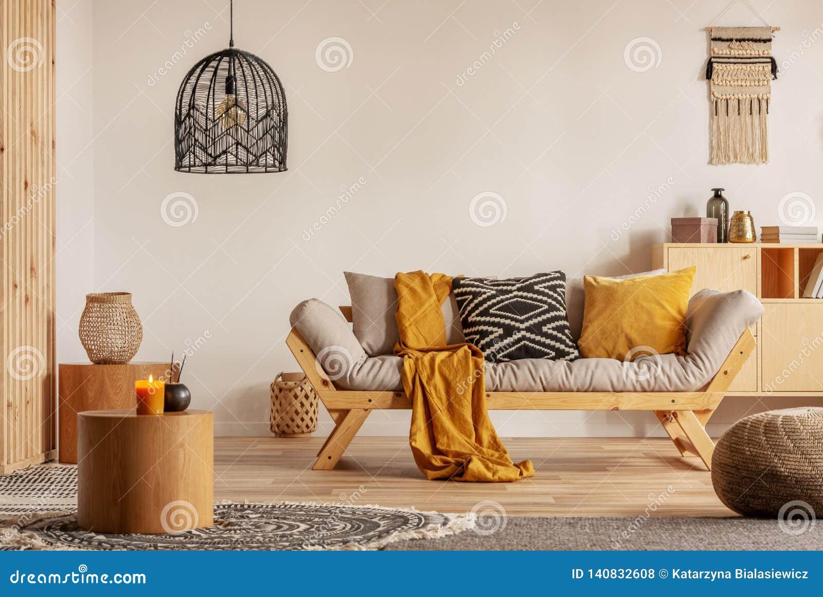 Wondrous Scandinavian Sofa With Pillows And Dark Yellow Blanket In Dailytribune Chair Design For Home Dailytribuneorg