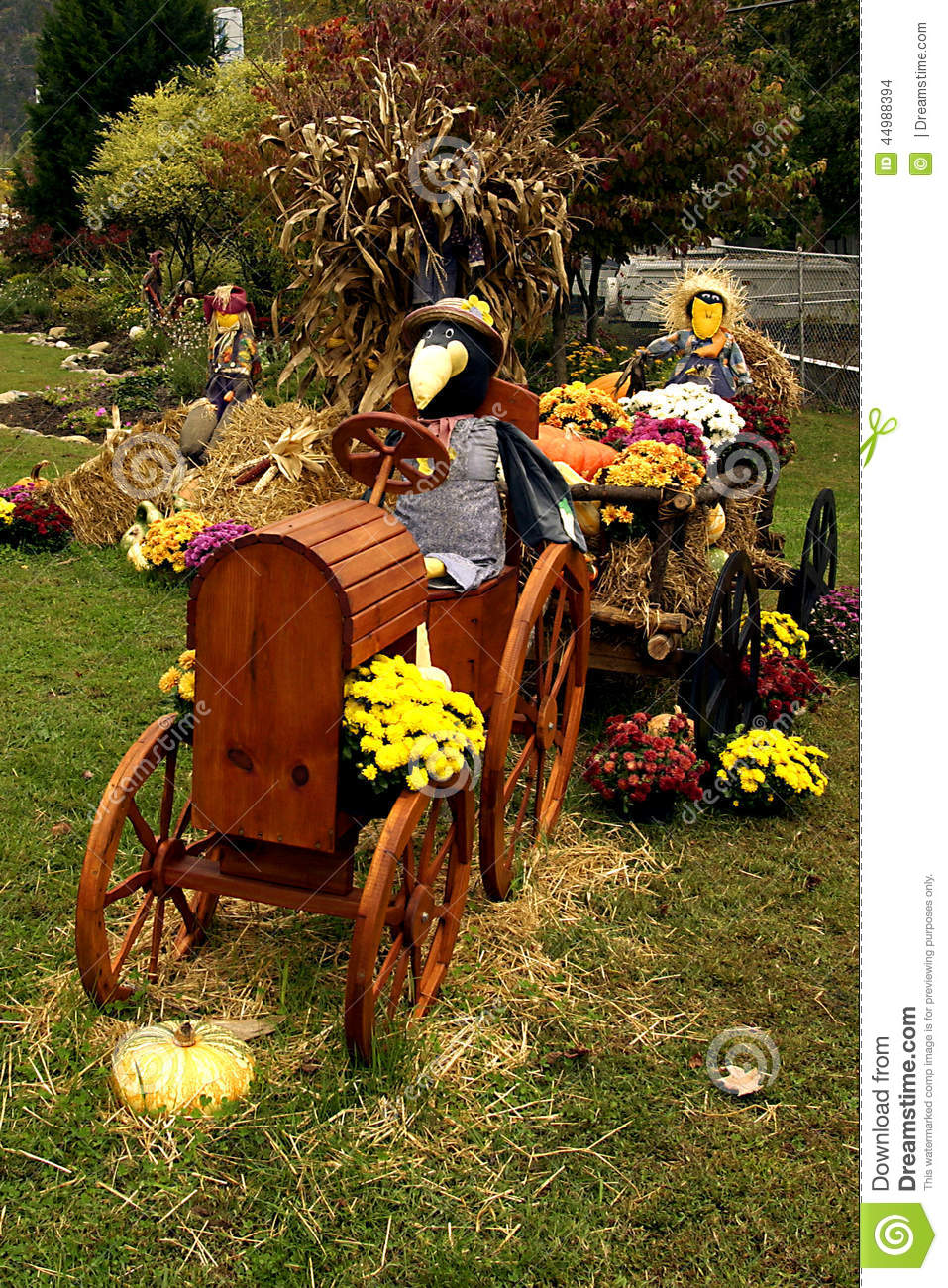 Scarecrow Driving Tractor Fall Decorations Stock Photo