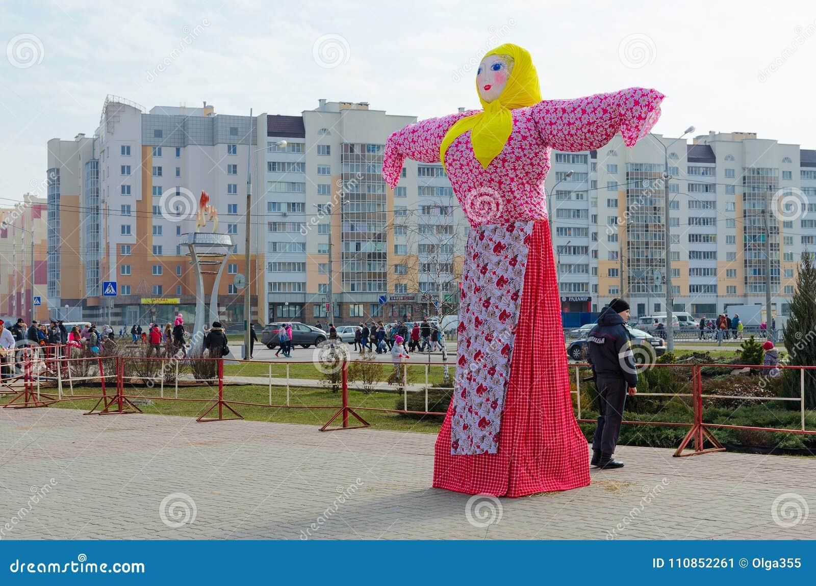 scarecrow of shrovetide on city street during shrovetide festivities