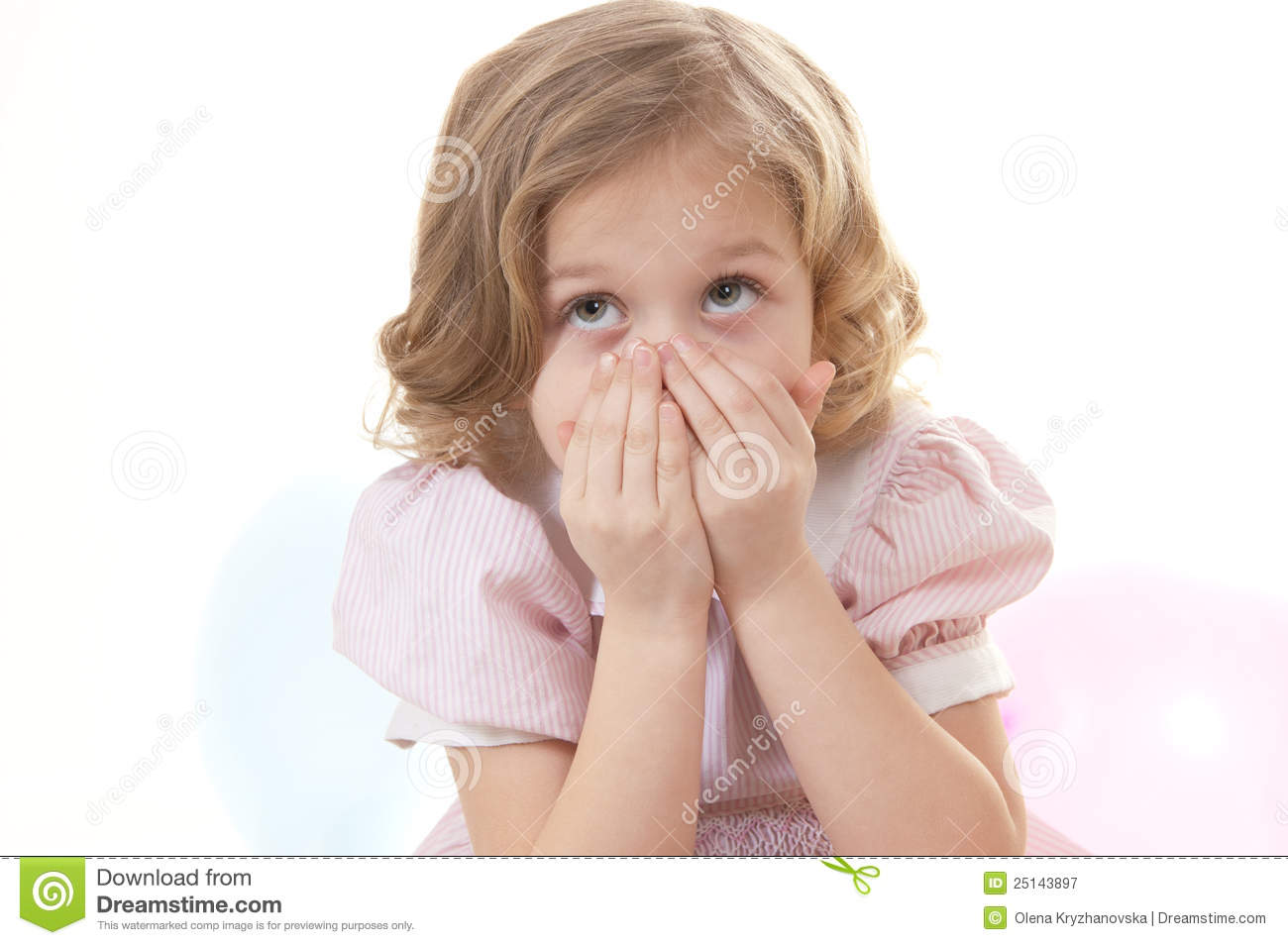 Scared adorable little blonde girl at the age of five wearing a pink