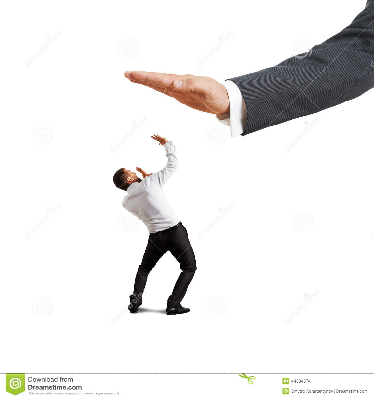 scared businessman looking up at big palm stock photo
