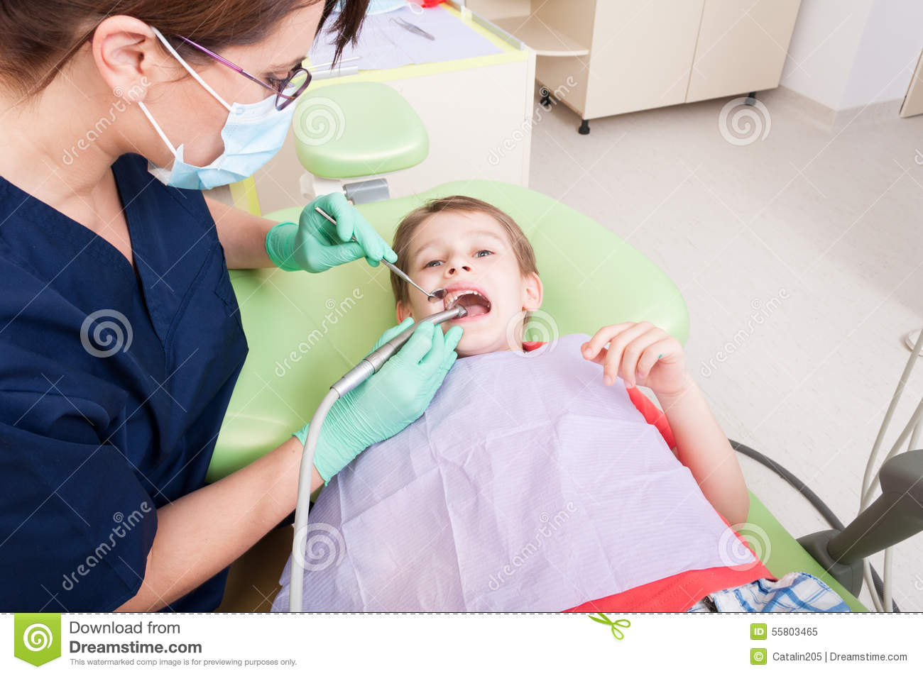 Scared Child On Drilling Procedure In Dentist Chair Stock