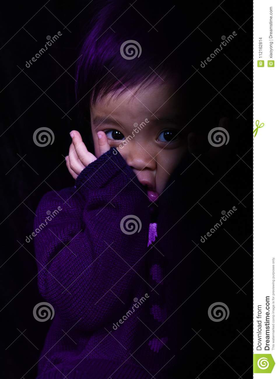 Scaring Asia baby girl in purple