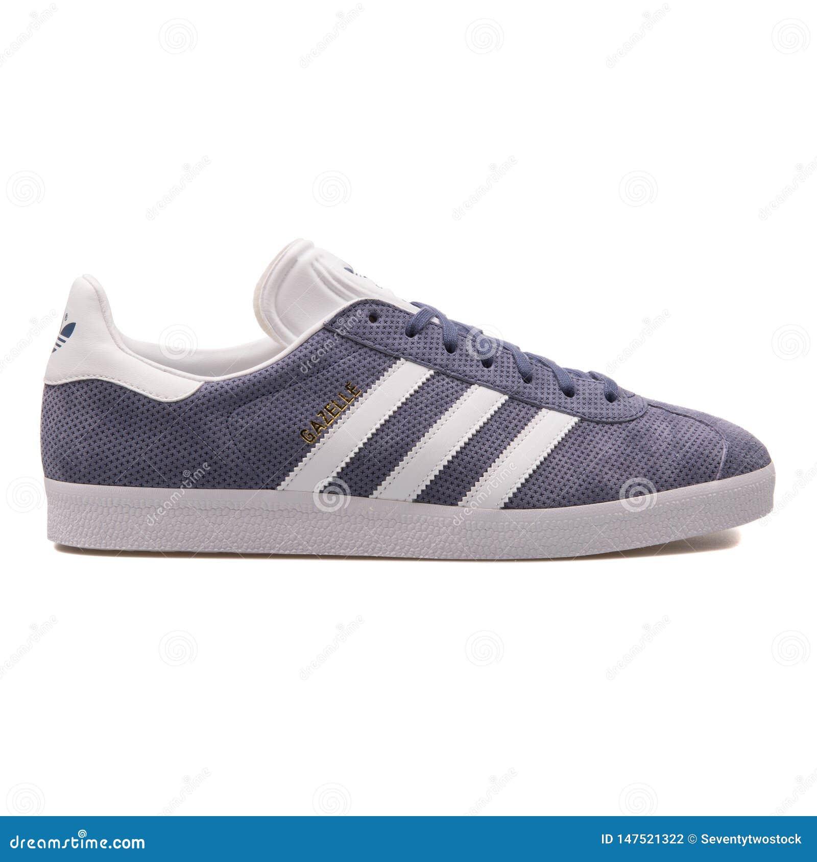 Scarpa da tennis porpora della gazzella di Adidas