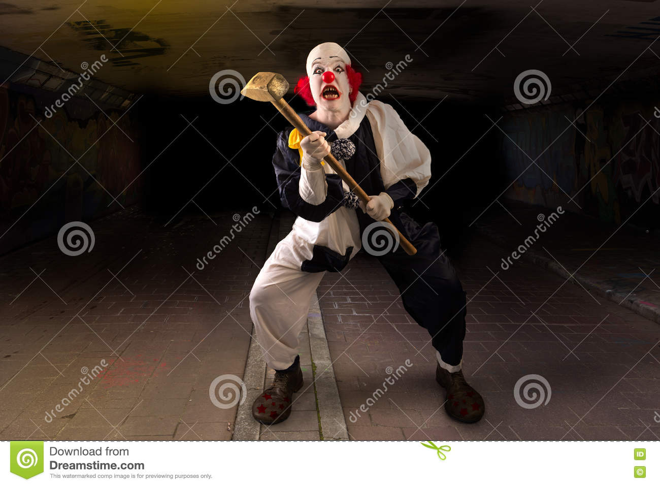 Scary clown with a hammer