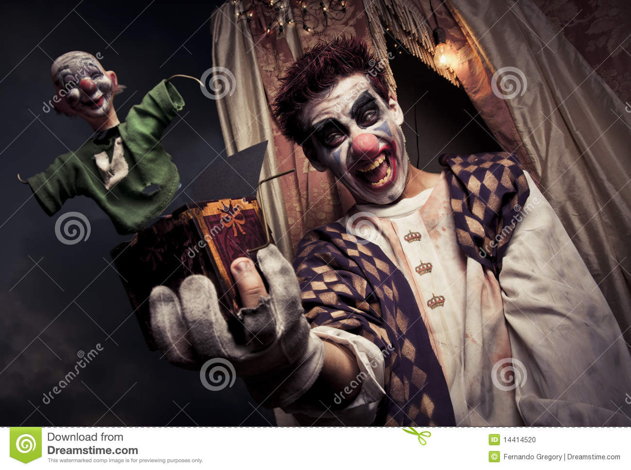 Royalty-Free Stock Photo & Scary Clown Holding A Jack-in-the-box Toy Stock Photo - Image ... Aboutintivar.Com