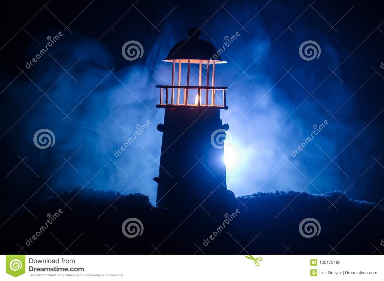 Scary dark ominous lighthouse behind a red fire background. Lighthouse at dusk/ Sunset Light House/ Light house at sunset. Decorat