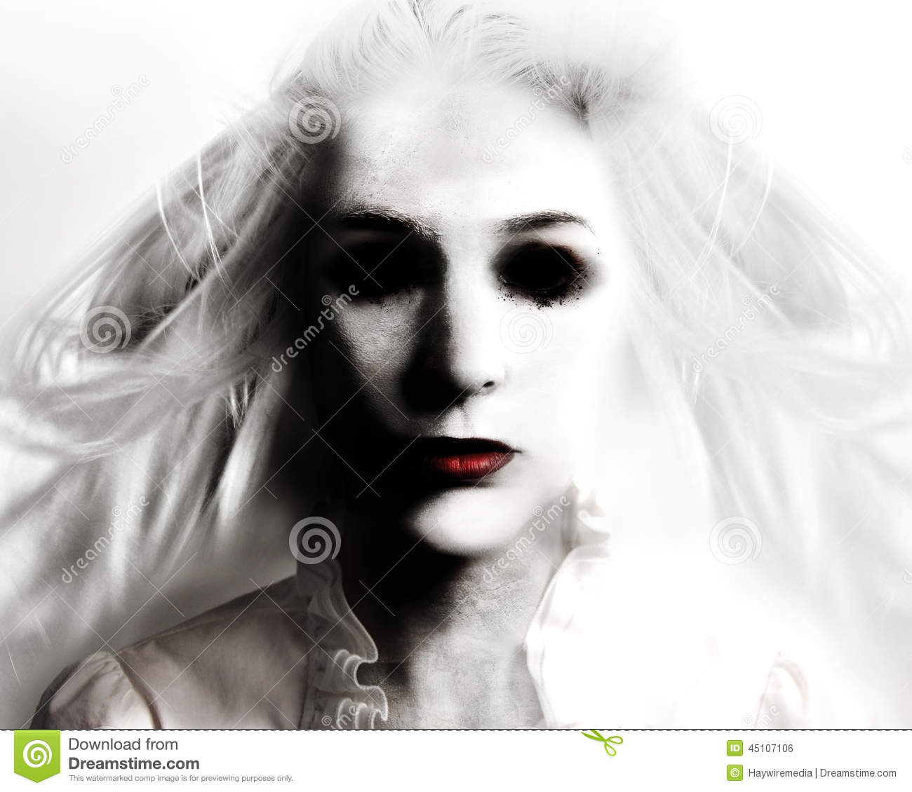 scary evil woman with black eyes and red lips is death on a white ...