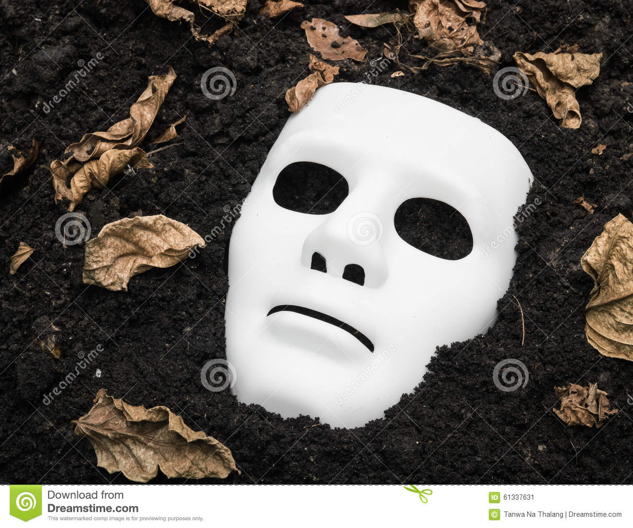 Scary Halloween Mask On The Ground Stock Photo - Image: 61337631