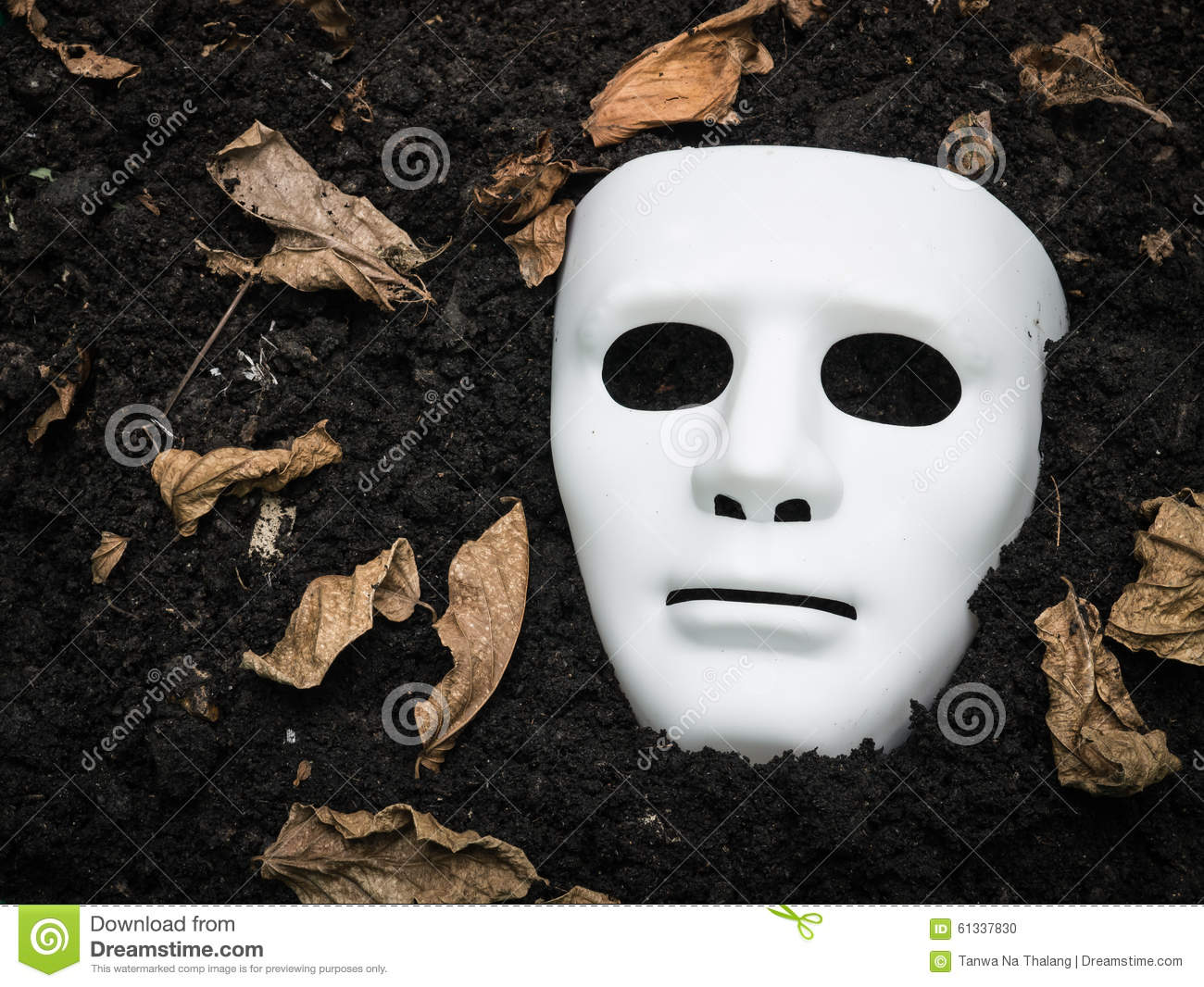 scary halloween mask on the ground stock photo - image of night