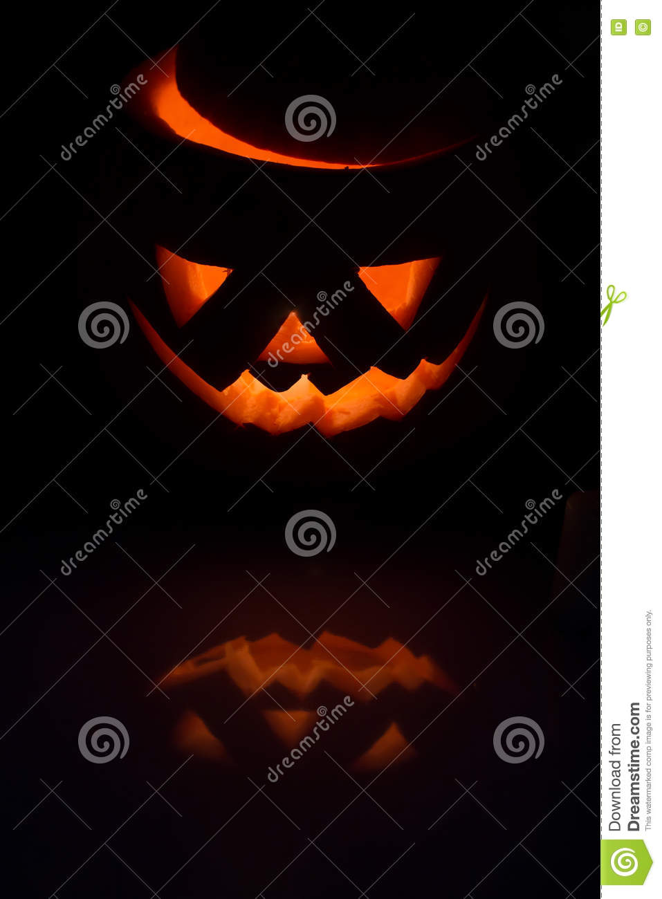 Scary Halloween pumpkin lantern ( jack-o -lantern) with burning candle inside