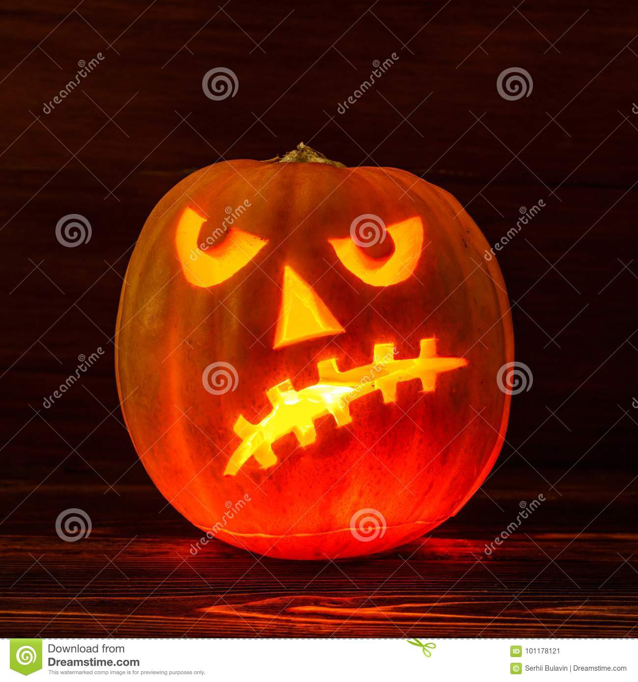 scary halloween pumpkin on wooden background scary glowing face rh dreamstime com