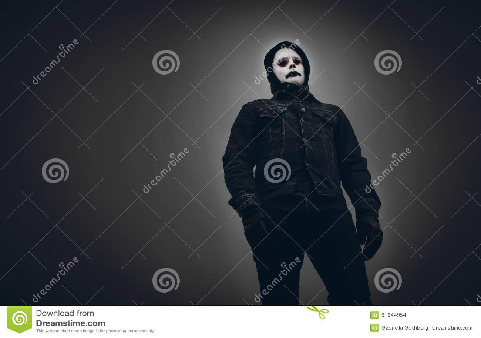 Scary looking, evil man in black hood.