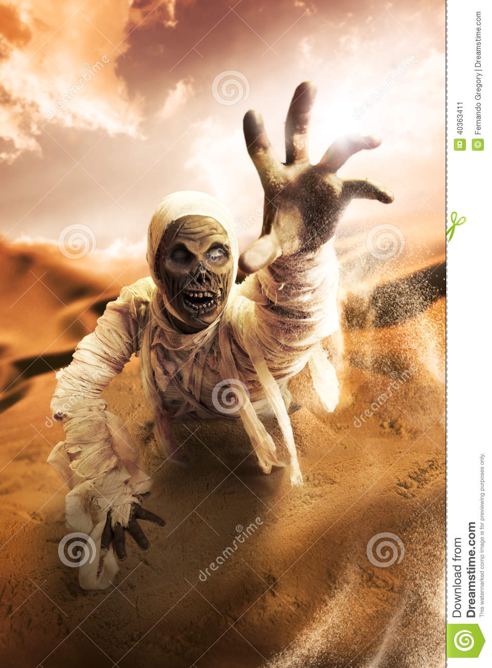 scary mummy in a desert at sunset stock image