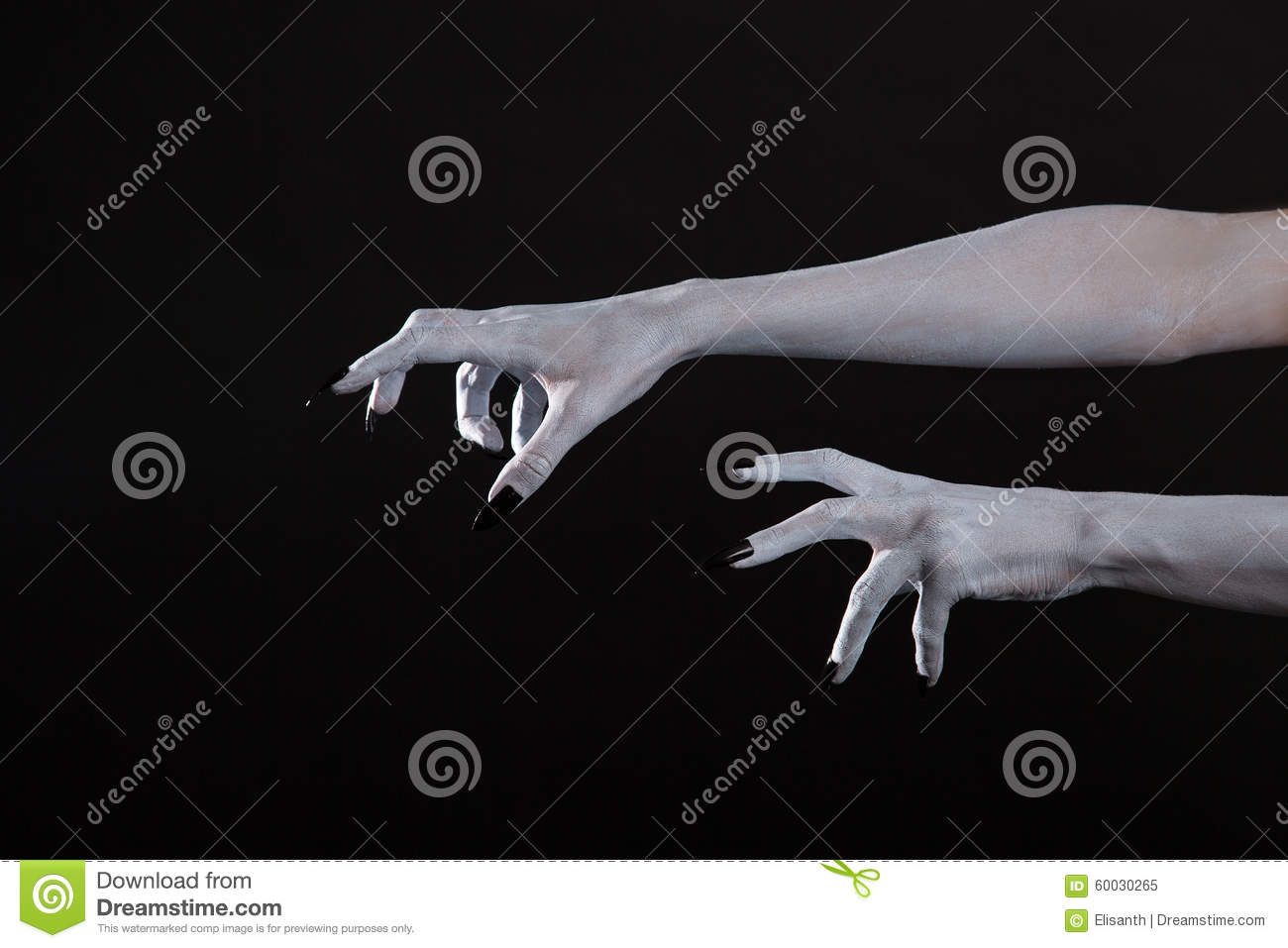 Scary pale Halloween hands with black nails