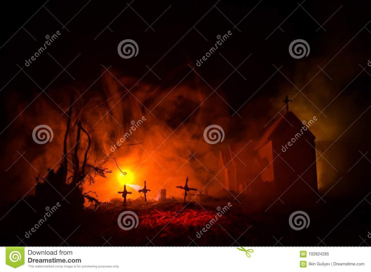 Scary view of zombies at cemetery dead tree, moon, church and spooky cloudy sky with fog, Horror Halloween concept