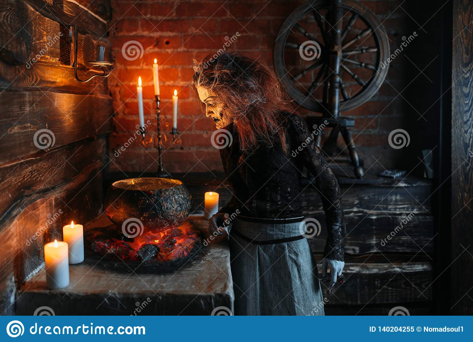 Scary Witch Reads Spell Over The Pot, Seance Stock Image - Image of