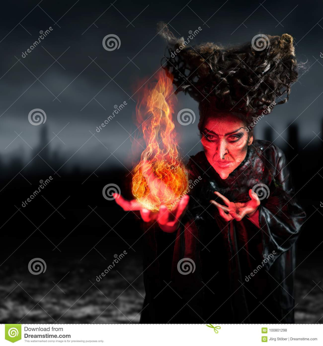 Scary witch summoning a spell