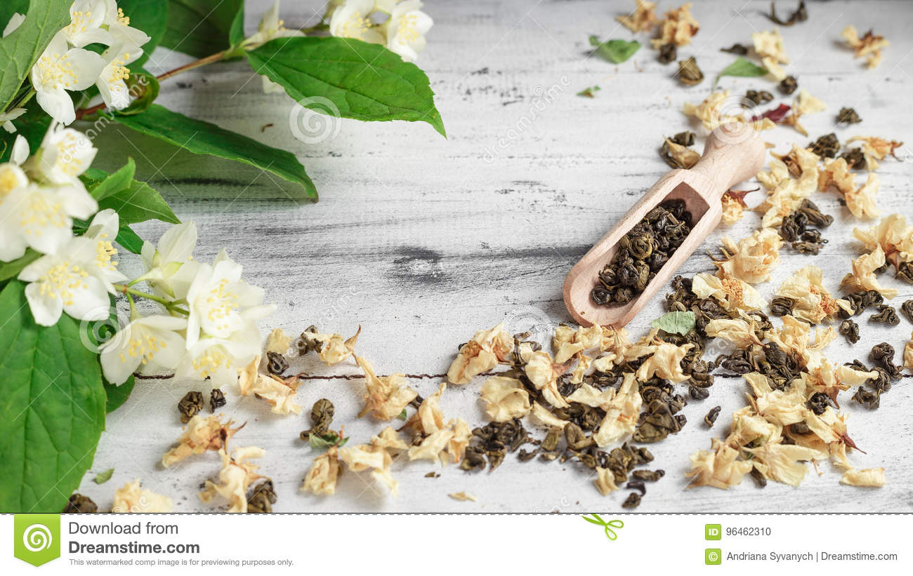 Scattered Green Tea Leaves With Jasmine Flowers Stock Photo Image