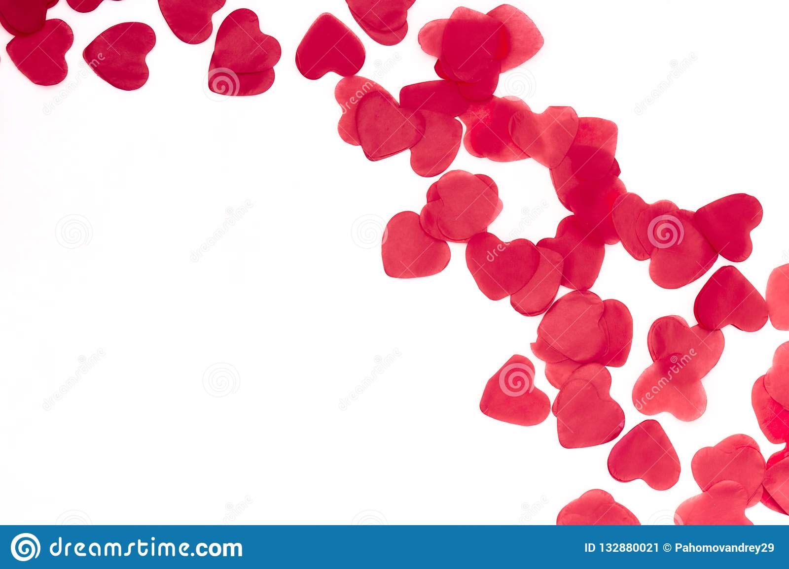 Scattered red hearts on a white background. Excellent background to the day of Saint Valentine.copy space