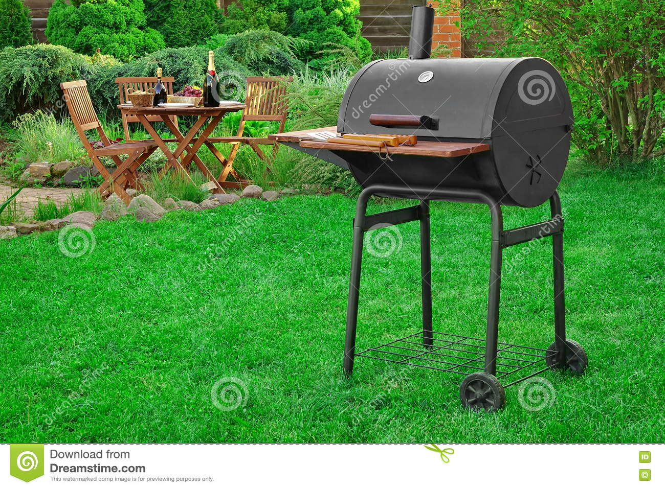 scene of barbecue grill party on lawn in the backyard stock photo