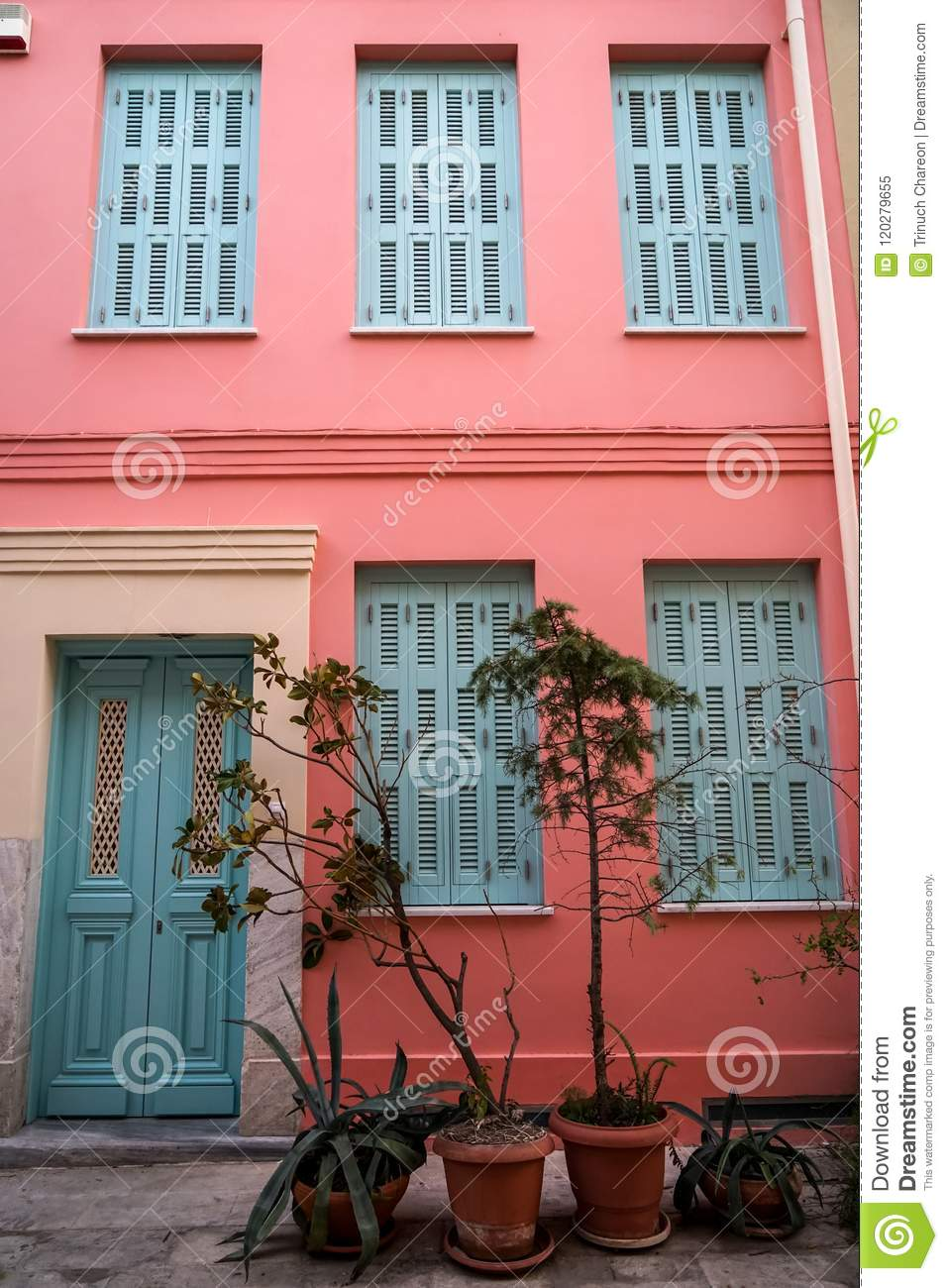 Scene Of Beautiful Urban Building Facade Background In Pastel Pink Plaster Paint Wall Light Blue Entry Door And Window Shutter Stock Image Image Of Pastel Building 120279655