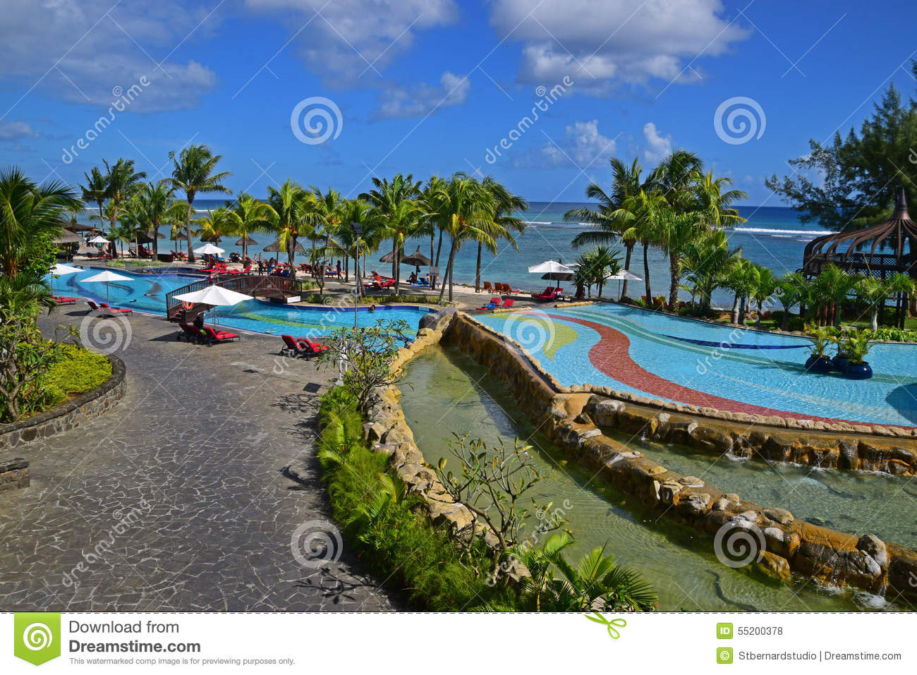 Scene of a resort swimming pool area at west coast of for Swimming pool mauritius