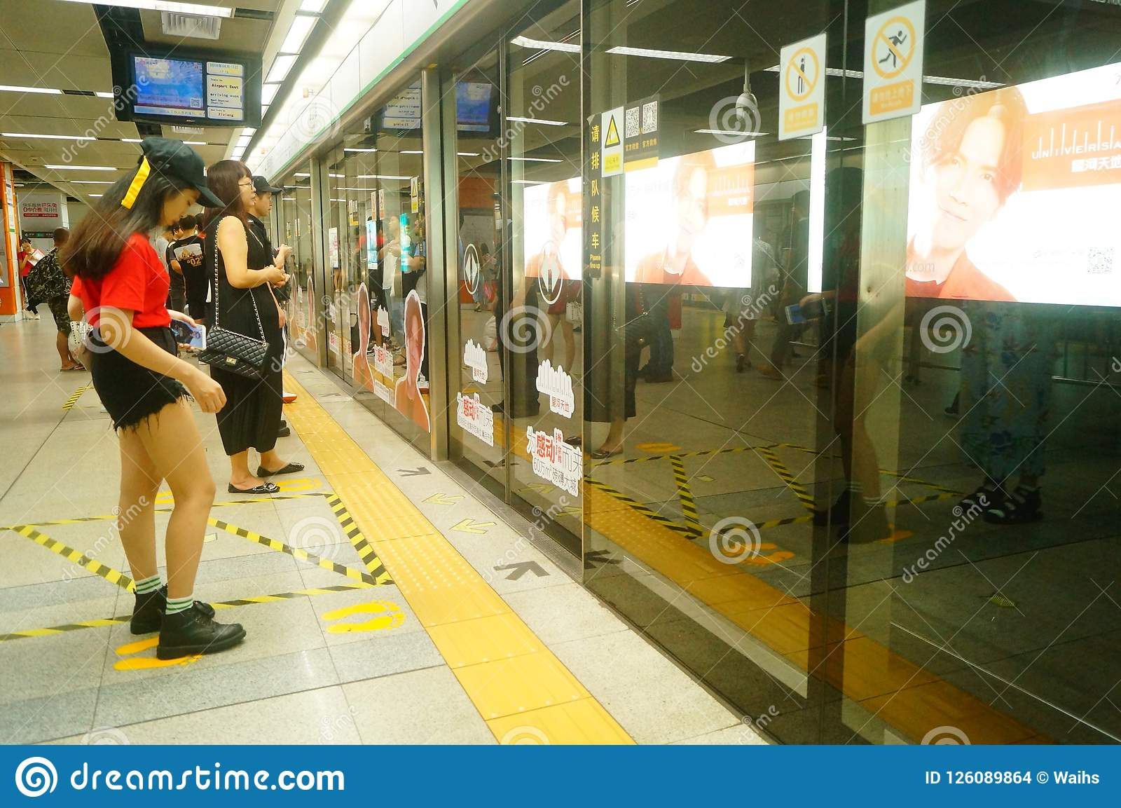 Shenzhen, China: landscape of Che Kung Temple subway station, male and female passengers