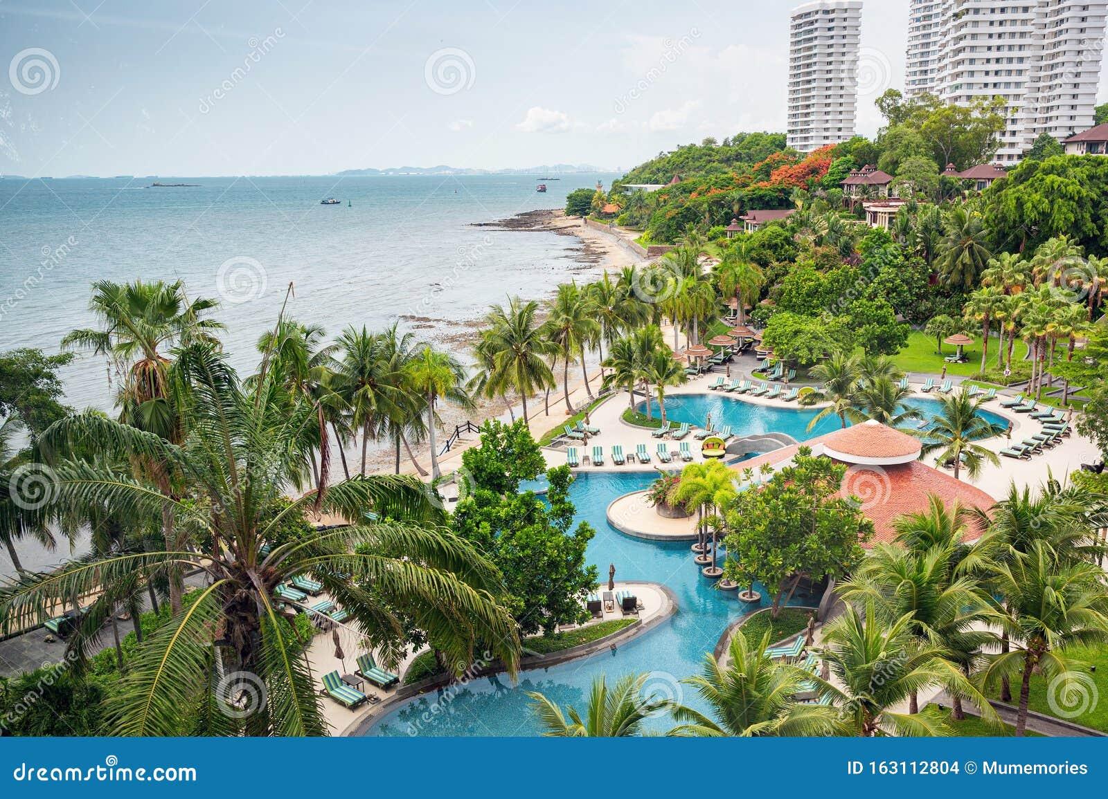 Scenery Of Luxury Resort Surrounding Green Garden With Swimming