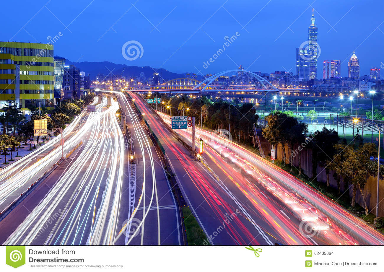 Scenery of the Taipei city, Xin-Yi District and downtown area with the MacArthur Bridge and car trials on Avenue