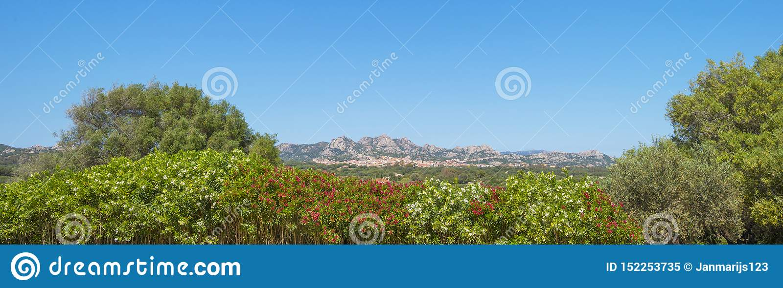 Scenic landscape of green hills and rocky mountains of the island of Sardinia