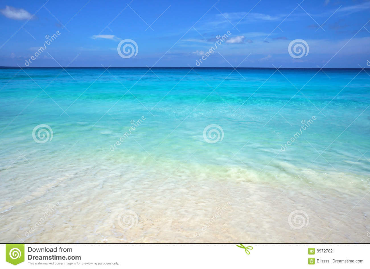 Scenic seascape of azure transparent ocean water and blue sky. Tropical beach with white sand. Idyllic scenery of seaside resort.