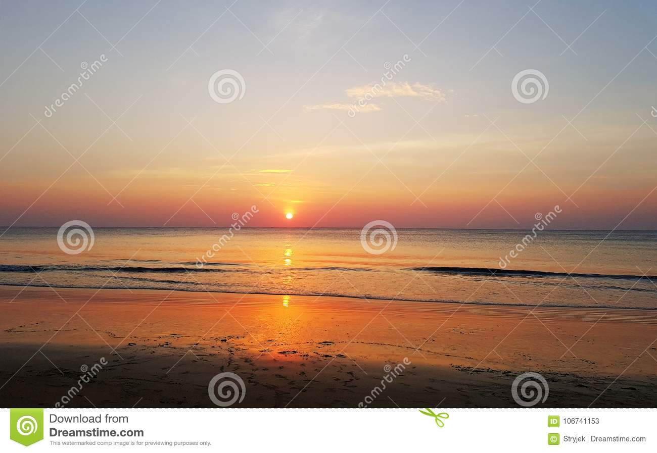 Scenic Sunset At The Sea Coast Good For Wallpaper Or Background Image