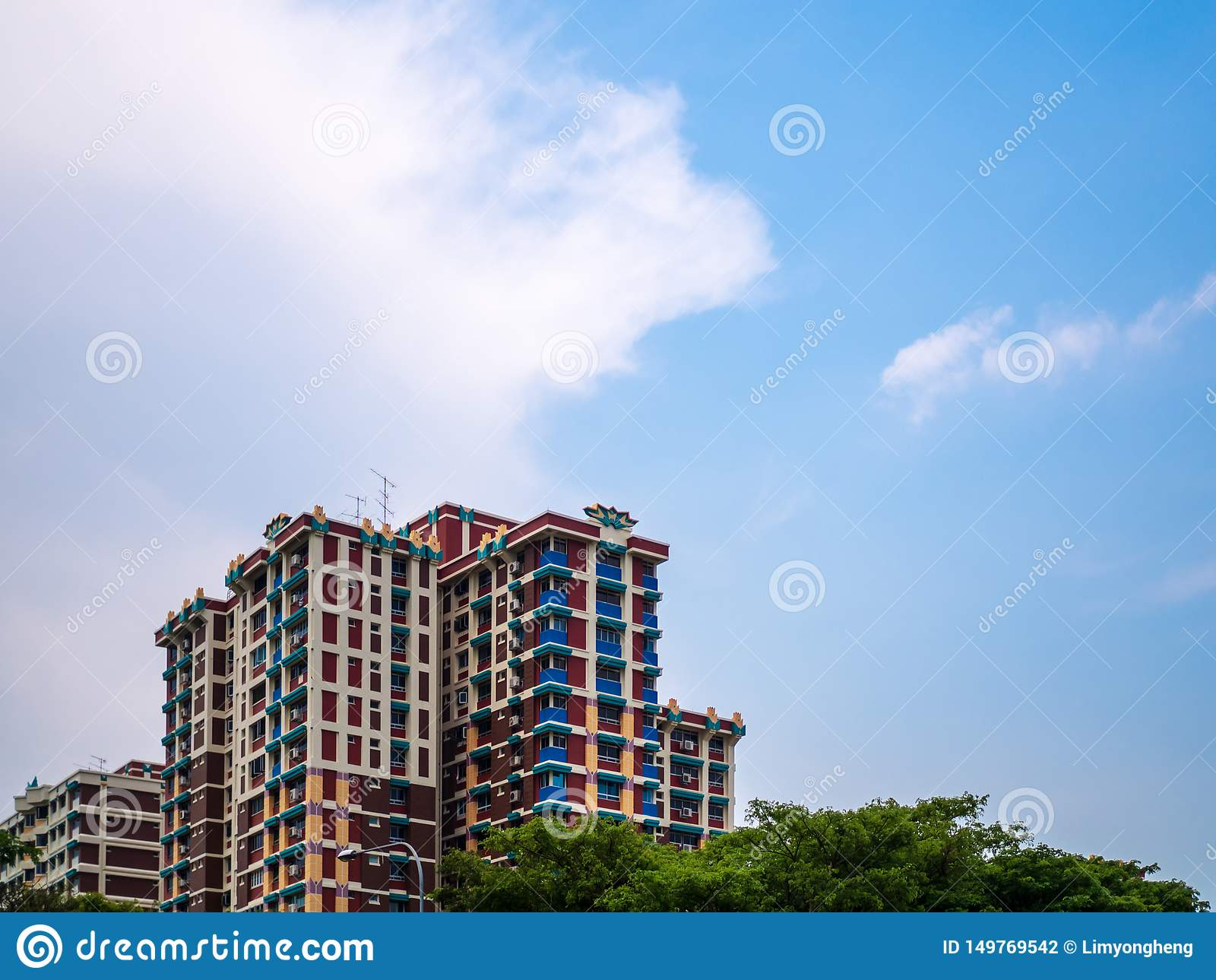 Scenic view of government built public housing in Singapore HBD flats against the blue sky
