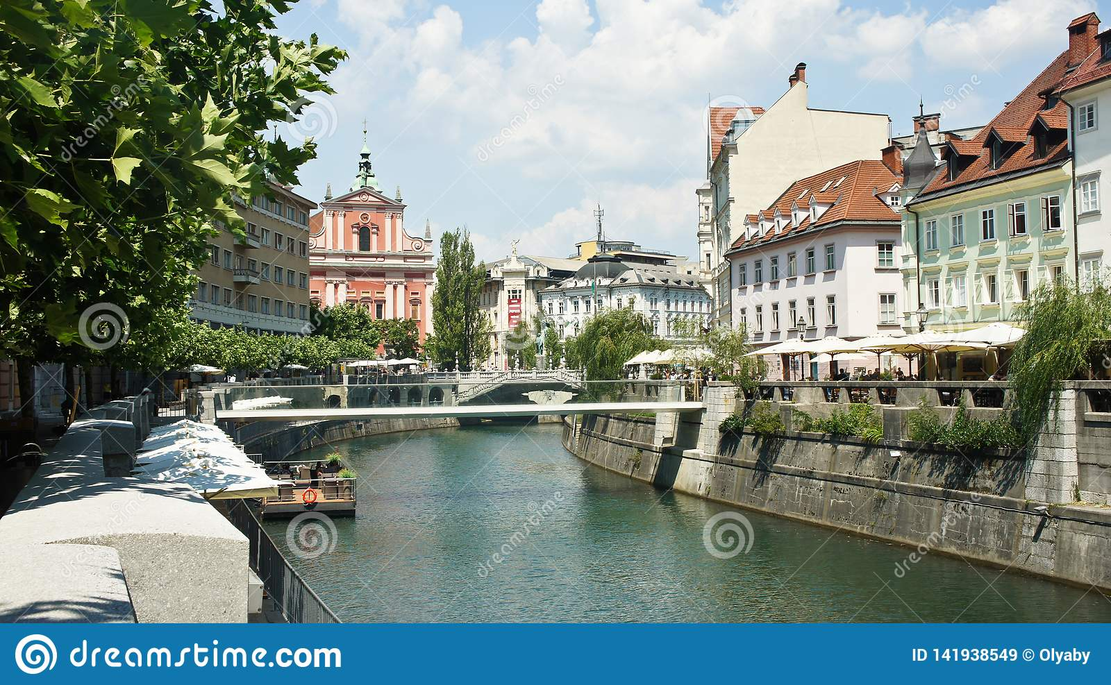 Scenic view of the houses on Ljubljanica river bank in old town, beautiful architecture, sunny day, Ljubljana, Slovenia