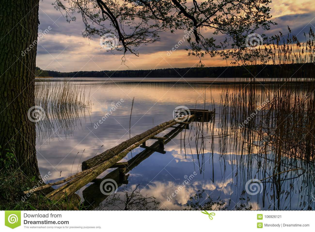 Scenic view of the lake at dusk in Brodnica Lake District, Poland, Europe