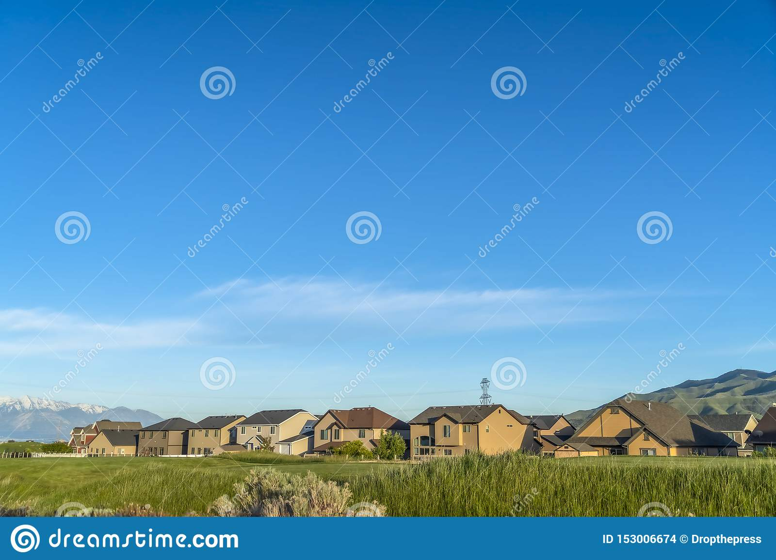 Scenic view of neighborhood in the valley with mountain and blue sky background
