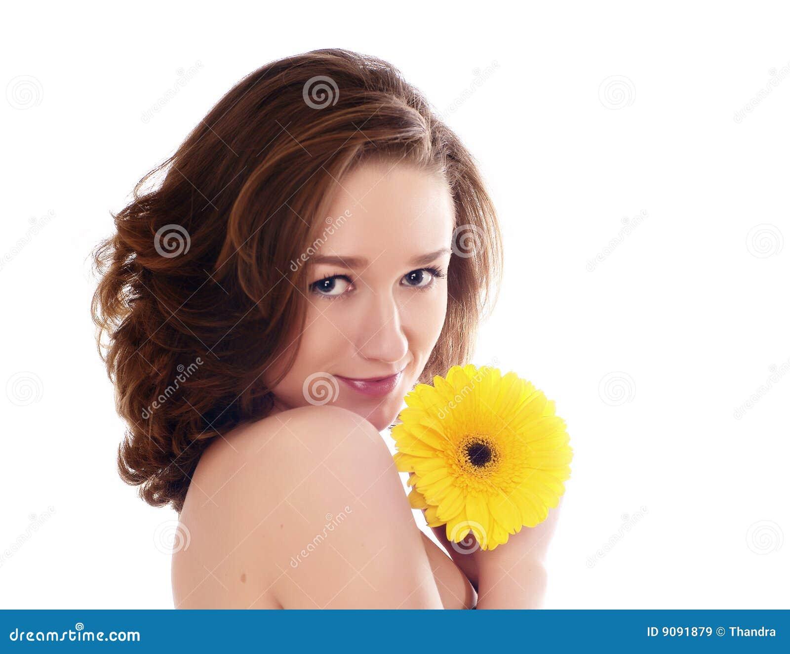 Schöne Frau mit Blume